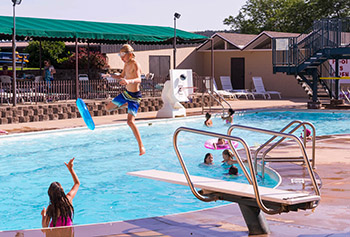 Kids frolicking in Arrowhead Country Club;s outdoor pool.